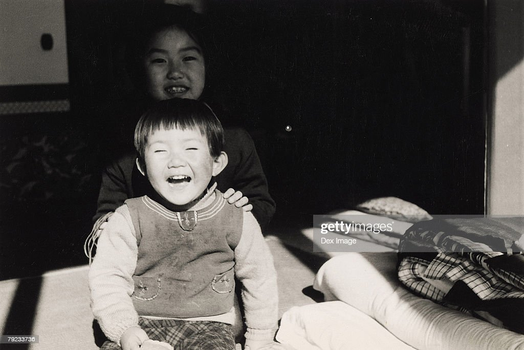 Elder sister and younger brother : Stock Photo