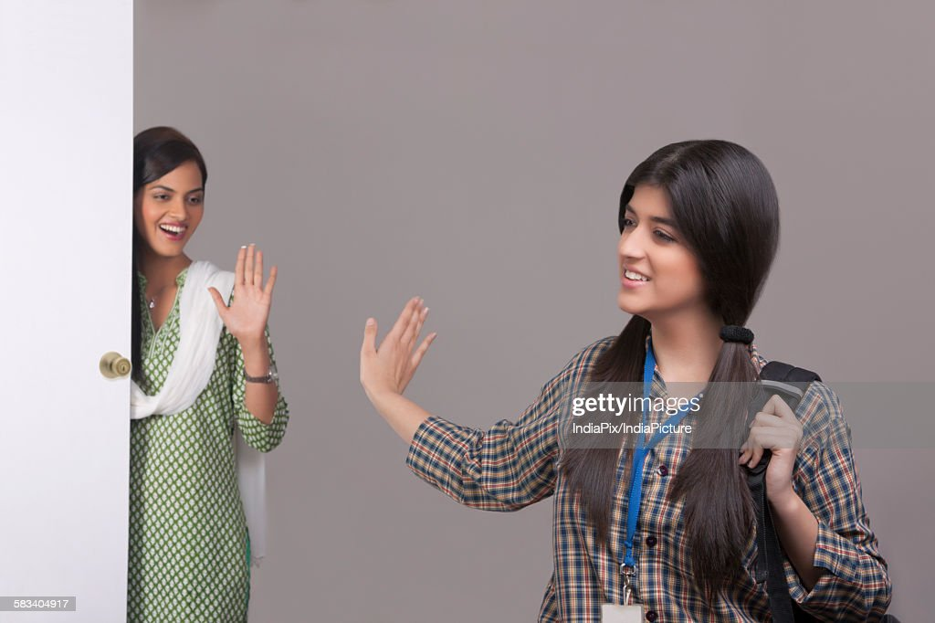 Elder sister saying bye to younger sister : Stock Photo