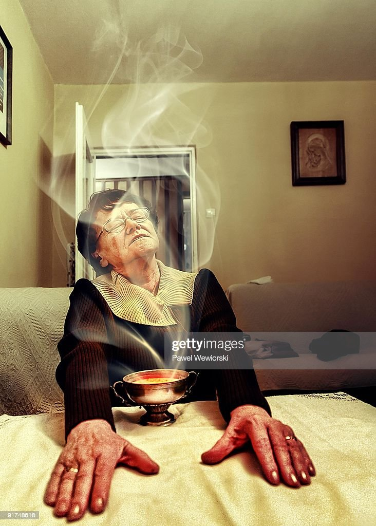 Elder woman over steamy soup : Stock Photo