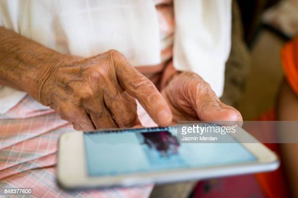 Elder woman using smart phone
