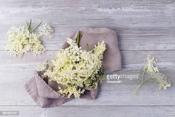 Elderflowerrs on cloth and wood