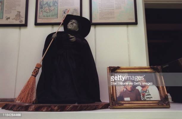 Elderhostel partipants at the Musser house A photo of Laura Jane Musser and actress Margaret Hamilton stands by a doll of the witch character from...