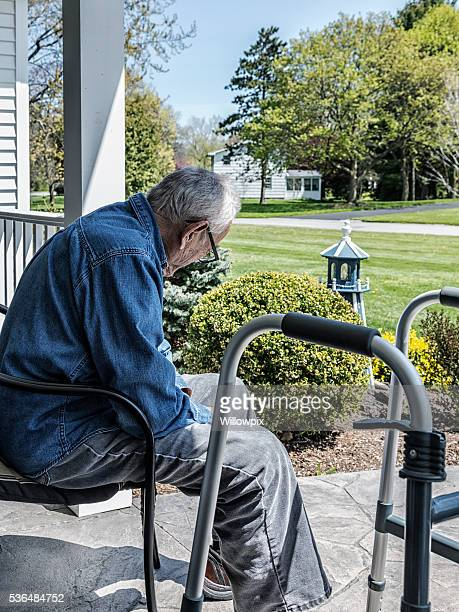 Elderly 93 Year Old Man Sitting On Home Front Porch