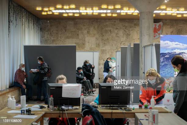 Elderly above 80 years of age who registered for vaccination wait in line to get vaccinated on February 11, 2021 in Kranj, Slovenia. Slovenia plans...