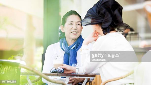 Elderly Asian Women Sharing Memories On A Sunny Summer Day
