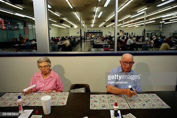 Elderly Bingo Players with Several Game Boards