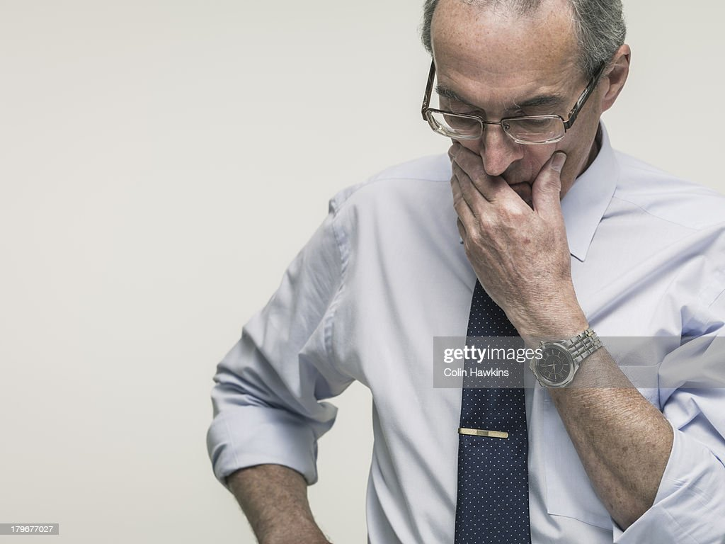 Elderly business man thinking : Stock Photo