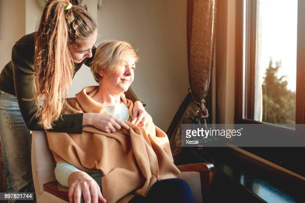 elderly care old and young - janitor stock photos and pictures