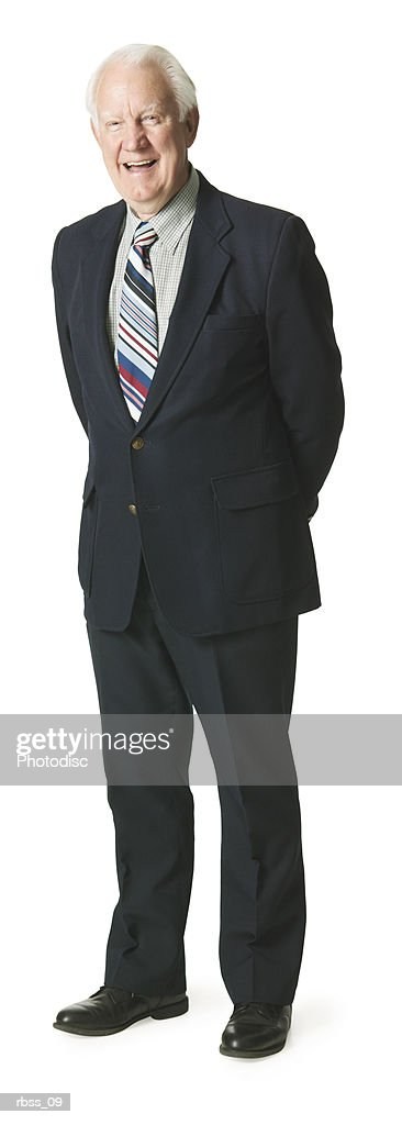 Elderly caucasian man in a suit smiles at the camera. : Foto de stock