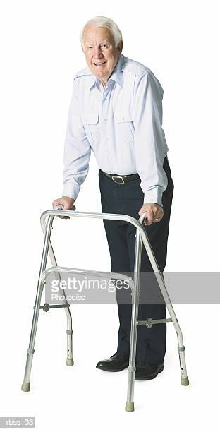 Elderly caucasian man with walker poses happily.