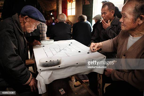 Elderly Chinese people playing Weiqi
