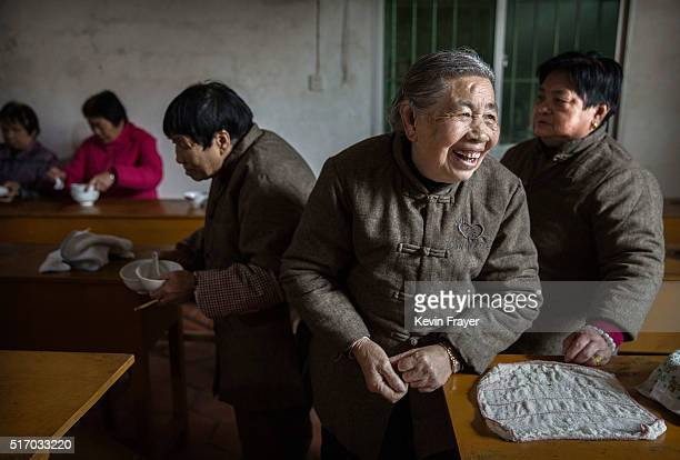 Elderly Chinese residents gather for lunch in the dining hall of the Ji Xiang Temple and nursing home on March 17 2016 in Sha County Fujian province...