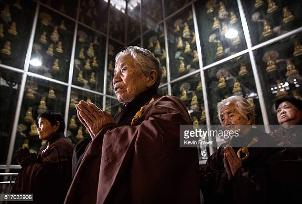 Elderly Chinese residents take part in a prayer and chanting session at the Ji Xiang Temple and nursing home on March 16 2016 in Sha County Fujian...