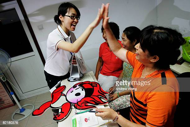 Elderly Chinese women learn English during a language lesson at a community center on August 5 2008 in Beijing China ahead of the Olympic Games which...