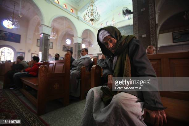 A elderly Christian man listens to a sermon in Saint Mark Coptic Orthodox Church in Giza on November 27 2011 in Greater Cairo Egypt There are an...
