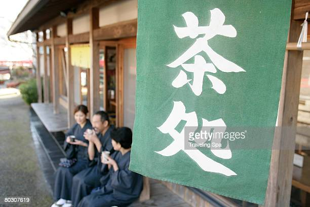 elderly couple and young woman relaxing at a teahouse - ティールーム ストックフォトと画像