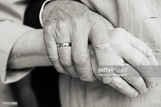 Elderly couple at golden wedding holding hands