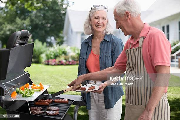 Elderly couple at the grill