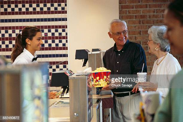Elderly Couple Buying Snacks at Movie Theater