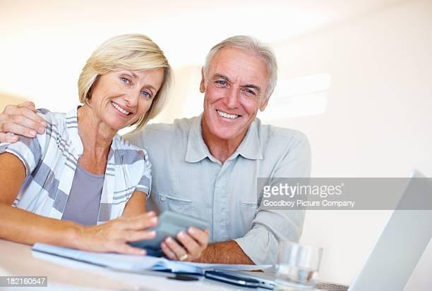 Elderly couple calculating budget