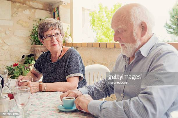 "elderly couple drinking coffee on an outdoor terrace in summer. - ""martine doucet"" or martinedoucet stock pictures, royalty-free photos & images"