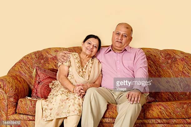 Elderly couple embracing, portrait