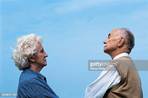 elderly couple face to face, looking pensive - confrontation stock pictures, royalty-free photos & images