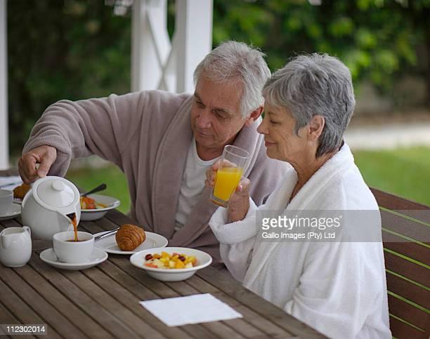 Elderly couple having breakfast, Bakoven, Western Cape Province, South Africa