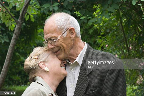 elderly couple hugging - hairy old man stock pictures, royalty-free photos & images