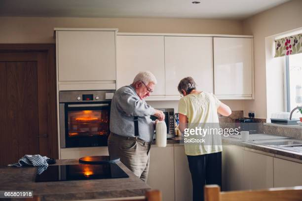 elderly couple in the kitchen - fat old lady stock photos and pictures