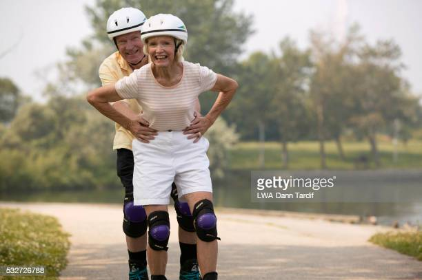 Elderly Couple Inline Skating