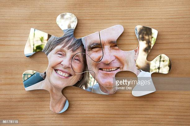 Elderly couple joined in puzzle
