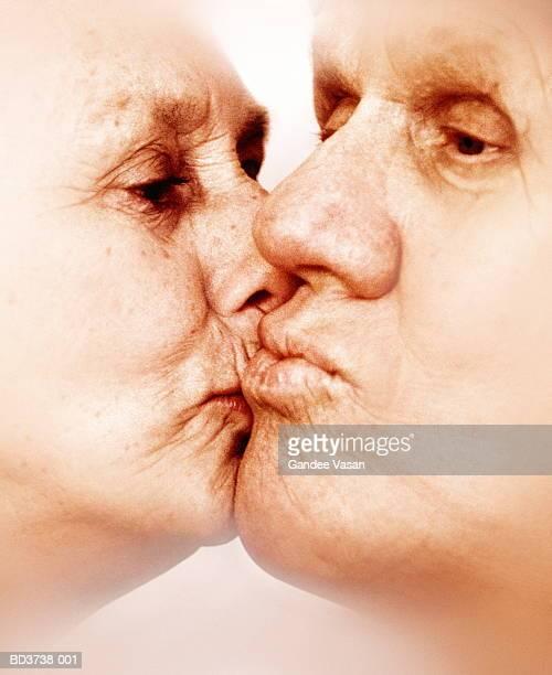Elderly couple kissing, close-up (soft focus)