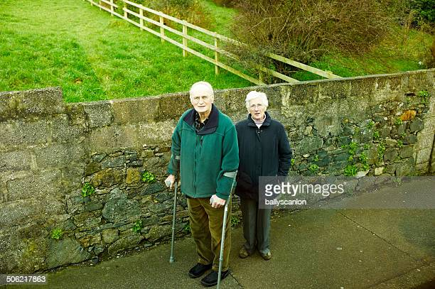 Elderly Couple Looking At Camera.