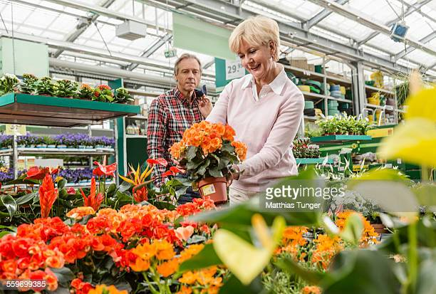 Elderly couple looking for some potted plants