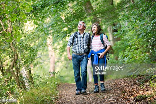 elderly couple out for a walk - woodland stock pictures, royalty-free photos & images