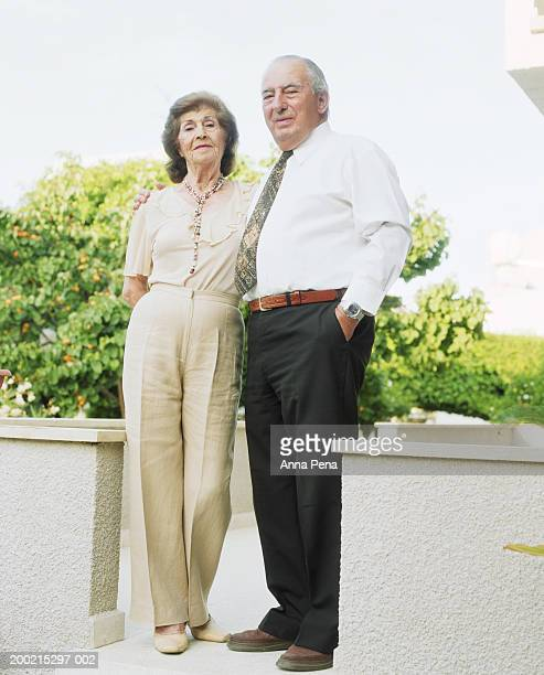 elderly couple, outdoors, portrait - beige pants stock photos and pictures