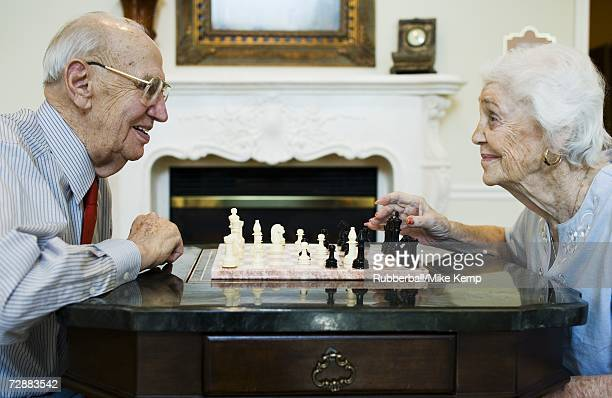 elderly couple playing chess - chess bildbanksfoton och bilder