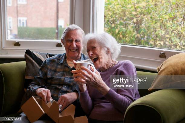 elderly couple receiving christmas presents - happy birthday richard stock pictures, royalty-free photos & images