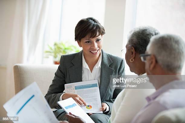 Elderly couple receiving financial consultation