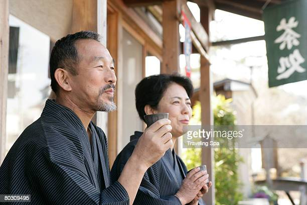 elderly couple relaxing at a teahouse, outdoor, close-up - ティールーム ストックフォトと画像
