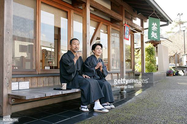 Elderly couple relaxing at a teahouse, outdoor