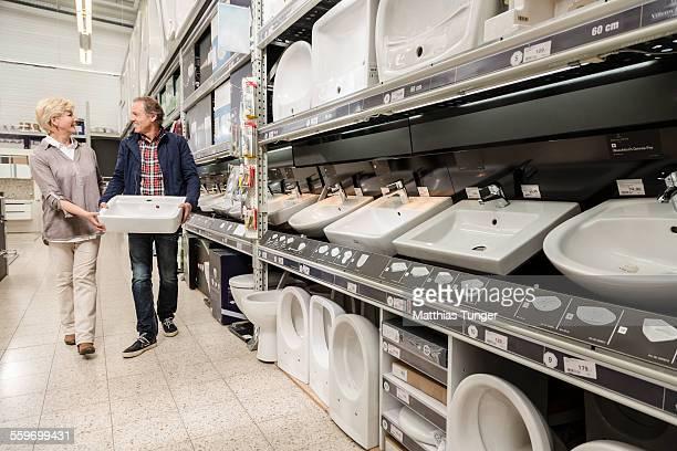 Elderly couple shopping a new washbasin