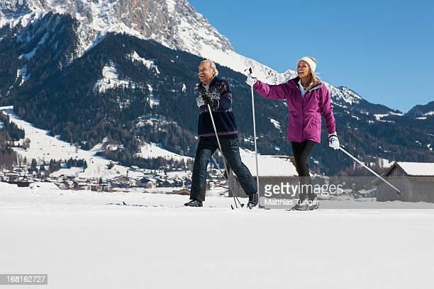 Elderly couple skiing cross-country