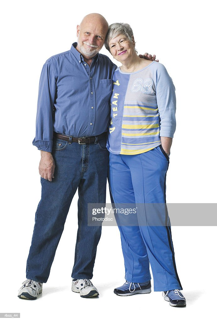 Elderly couple smile as they lean together. : Foto de stock