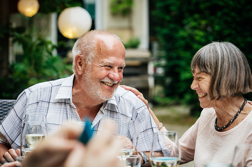Elderly Couple Smiling At Family BBQ - gettyimageskorea