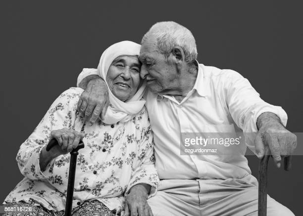 elderly couple still in love - arab old man stock pictures, royalty-free photos & images