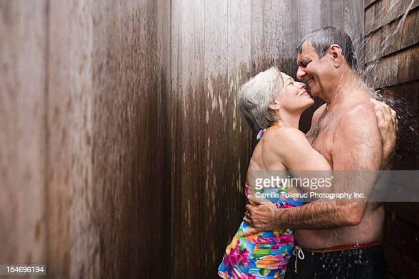 elderly couple taking a shower together - oben ohne frau stock-fotos und bilder