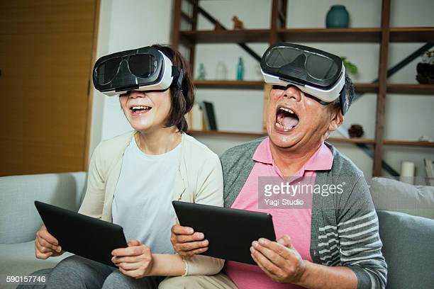 Elderly couple trying out some virtual reality headsets