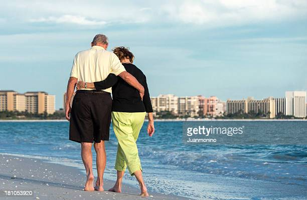 elderly couple walking about the beach - marco island stock pictures, royalty-free photos & images